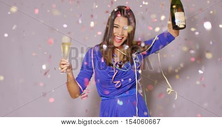 Giggling happy woman celebrating the New Year