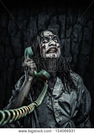 Horror zombie girl calling by phone
