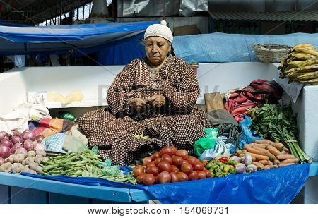 Indigenous Bolivian woman selling vegetables at the market in La Paz, October 3, 2012 - Bolivia