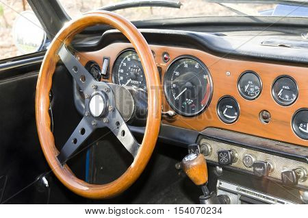 wooden dashboard of a vintage sports car