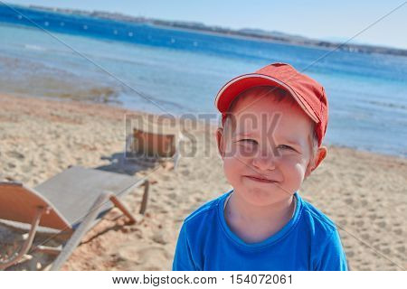 Happy smiling boy at Red Sea Shore