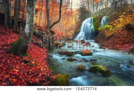 Autumn Forest With Waterfall At Mountain River At Sunset