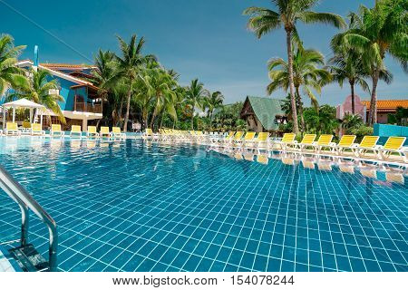 gorgeous beautiful inviting view of  tropical swimming pool on sunny bright day