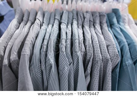 Shirts on hangers close up. Shirts on hangers. Clothing store. Men's wear. Men's shirts.