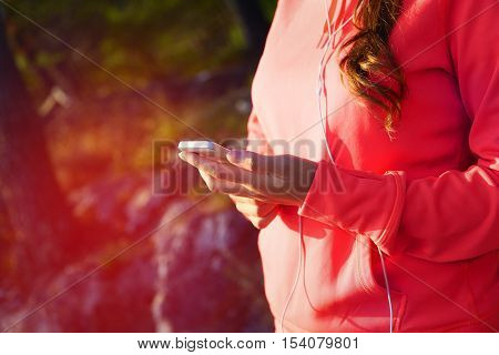 Young Girl In Sport Outfit Using Her Smartphone
