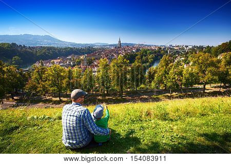 Father and his little son enjoying the view of Bern old city. Bern is capital of Switzerland and fourth most populous city in Switzerland.