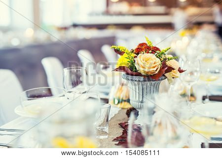 Wedding table. Flowers arrangement bouquets as decoration for wedding.