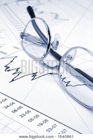 Stock Chart And Eyeglasses