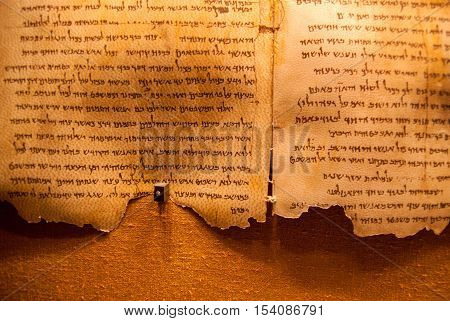 QUMRAN ISRAEL - JANUARY 10 2010: Dead Sea Scrolls on display at the caves of Qumran. They consist biblical and non-biblical manuscripts