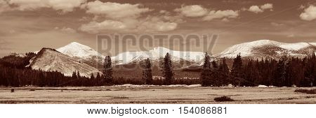 Grassland and snow mountain BW with cloud in Yosemite.