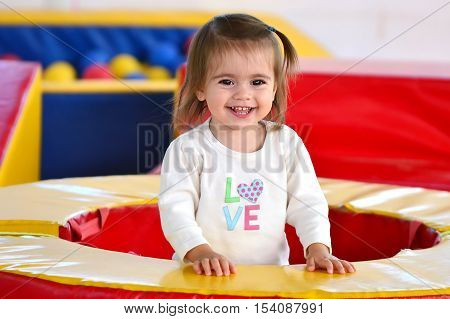 Child Plays In Play Center