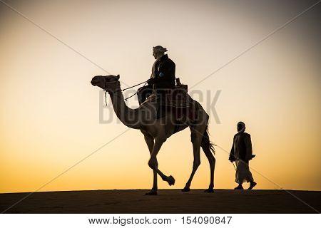 Meroe pyramids Sudan December 19th 2015: man on a camel walking in a desert in Sudan