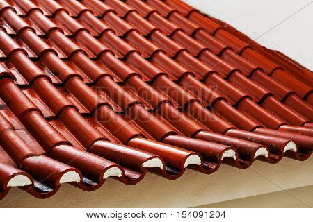 Roof tiles - red tiles or shingles on house as background and copy space.