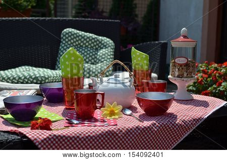 Colorful Dishes In A Garden