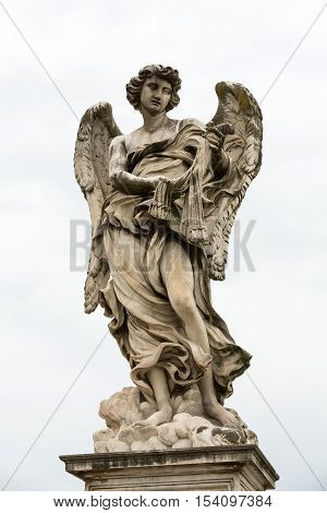 Marble statue of Angel with the Whips by Lazzaro Morelli from the Sant'Angelo Bridge in Rome Italy
