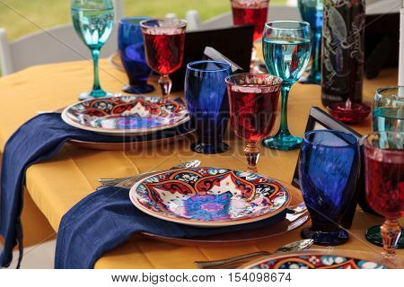 Red and royal blue table setting to celebrate dia de los muertos in October.