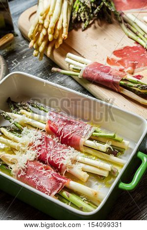 Preparation Of Asparagus Wrapped In Parma Ham With Cheese