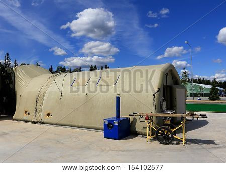 Field mobile hospital on the basis of the pneumatic modules - inflatable frame (pneumoframework) which stretched from the top of the tent PVC fabrics
