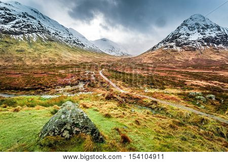 Footpath in Glencoe mountains in cloudy day
