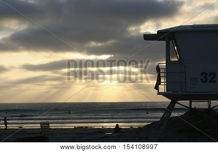 Silhouette of a lifeguard tower at La Jolla Shores Beach at Sunset.