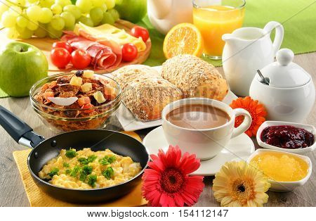 Breakfast Served With Coffee, Juice, Egg, And Rolls