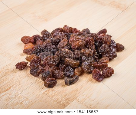 Fruits. Raisins on a wooden cutting board.