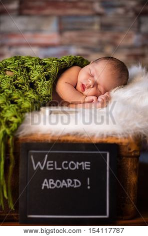 Sweet and innocence newborn baby sleeping on softy blanket