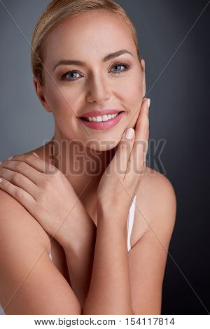 Nice portrait of beautiful maturity woman with gentle tan