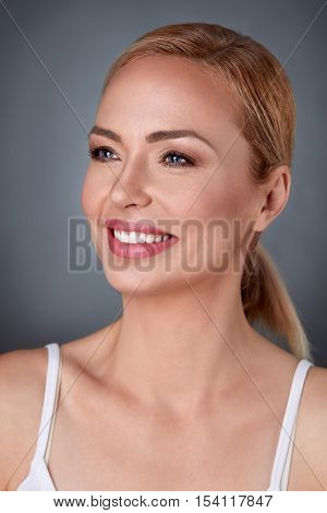 middle aged woman smiling, healthy and positive female