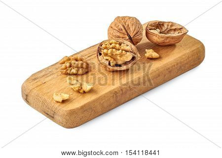 Walnuts on wooden board. Close-up isoated on white background