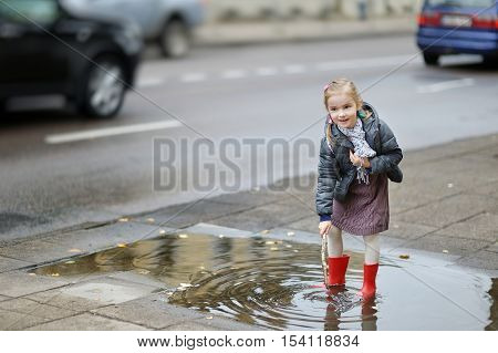 Adorable Girl On A Rainy Day At Autumn