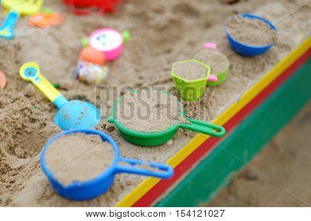 Some plastic sandbox toys on autumn day
