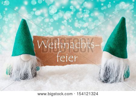 German Text Weihnachtsfeier Means Christmas Party. Christmas Greeting Card With Two Turqoise Gnomes. Sparkling Bokeh Background With Snow. German Text Frohes Fest Means Merry Christmas