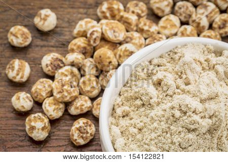 organic tiger nuts, a rich source of resistant starch - peeled nuts and powder for smoothies