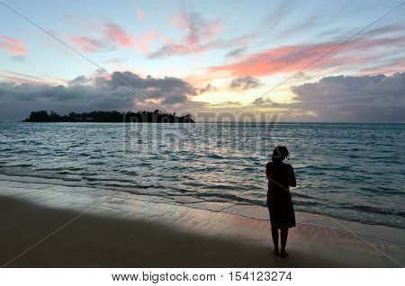 Young Woman Looks At The Sunrise Of Tropical Island