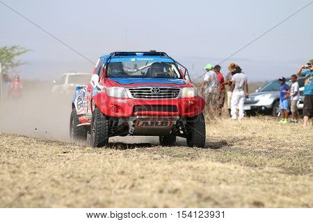 Speeding Red And Blue Toyota Hilux Single Cab Rally Car Front View