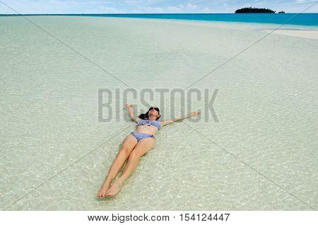 Young Woman Bathing On Aitutaki Lagoon Cook Islands