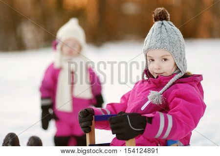 Two Little Girls At Sunset At Winter