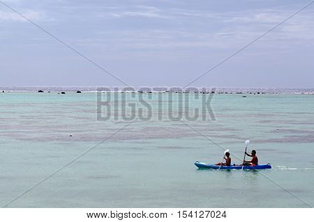 ACouple kayaking over Aitutaki Lagoon. The island was nominated