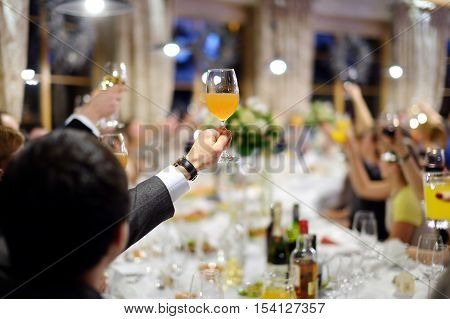 Men's Hand Holding Glass Of Juice