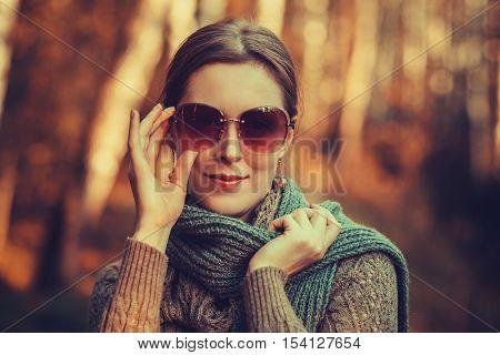Young fashion woman in glasses autumn portrait. Vintage film style colors.