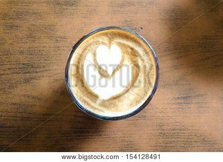 Top view of latte art foam on hot latte drink