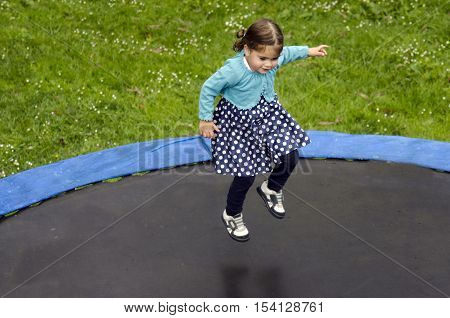 Girl (Talya Ben-Ari age 3) jumps on trampoline. Statistics show that about 80000 children were treated in hospital emergency rooms for trampoline-related injuries every year