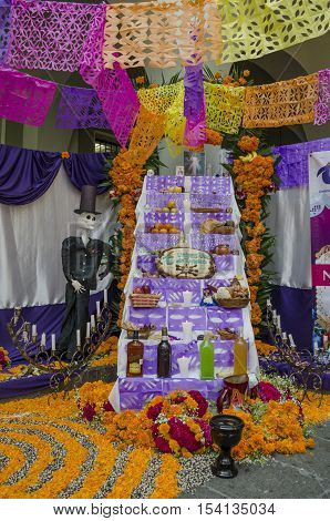 XALAPA, VERACRUZ, MEXICO- OCTOBER 28, 2016: Traditional mexican day of the dead offering altar with a catrin in Xalapa, Veracruz, Mexico