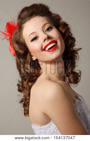 Gorgeous pin-up bride close-up. Professional make-up hair and style