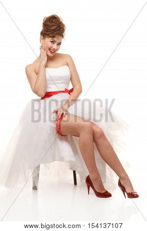 Sitting pin-up bride.Professional make-up hair and style