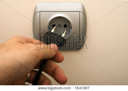 Man Plugging Wall Socket