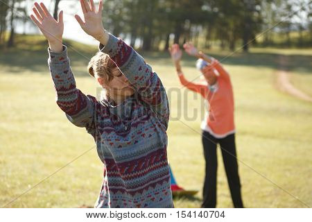 Two woman are practicing Qi Gong in the morning
