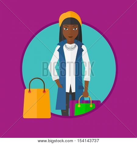 An african-american woman holding shopping bags. Happy young woman carrying shopping bags. Woman with a lot of shopping bags. Vector flat design illustration in the circle isolated on background.