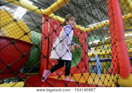 A Little girl play in indoor playground.